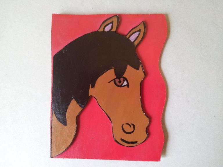 cheval en bois découpé